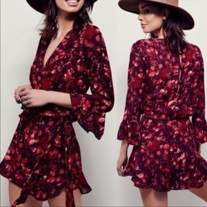 FREE PEOPLE ALL THE RIGHT RUFFLES ROMPER SIZE XS